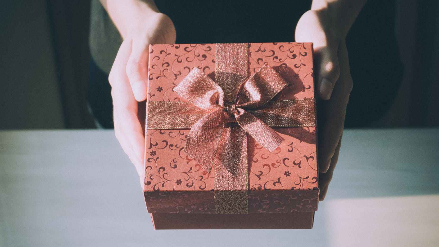 This is a photo of hands holding a box, which is symbolic of holding adoption loss and grief. Helping adoptees and foster kids to open it and look inside seems impossible. However, this practical tool will facilitate active grieving.