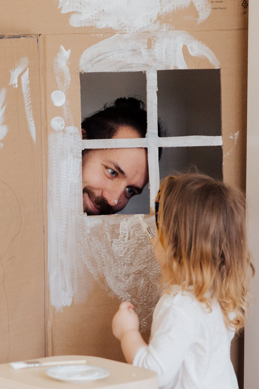 photo of man looking on child